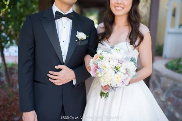 A couple hand-in-hand at their wedding.