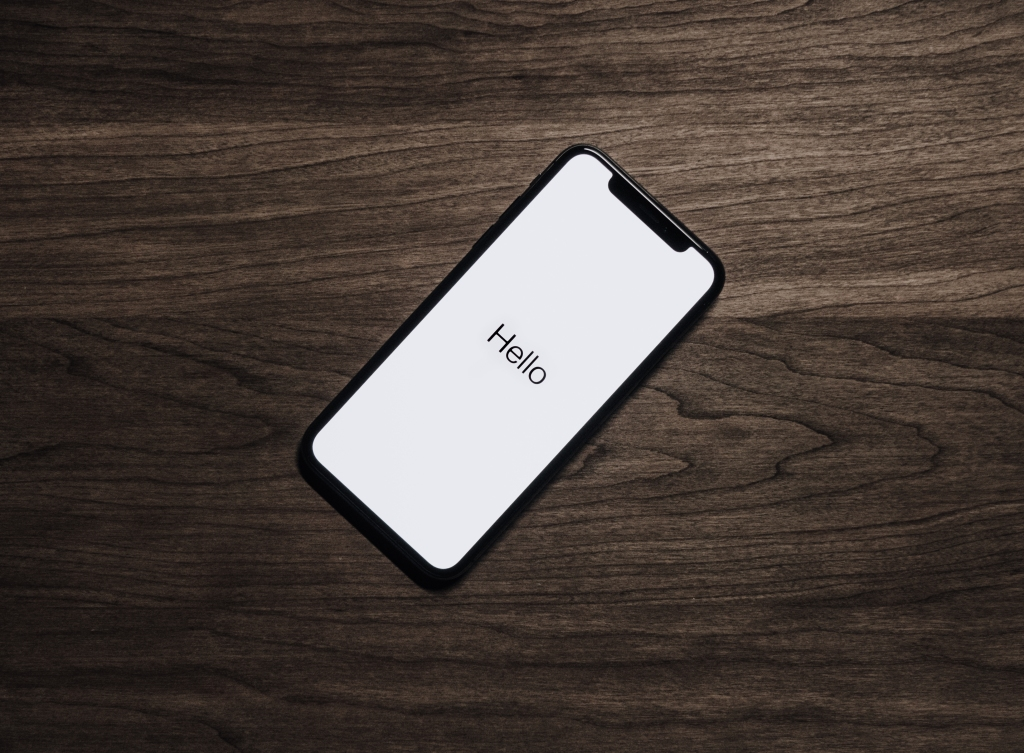 iphone x with hello on start screen on a wood kitchen table in san francisco california