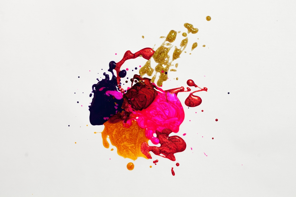 paint splatter on canvas with red and gold and blue and orange and pink and paint and art