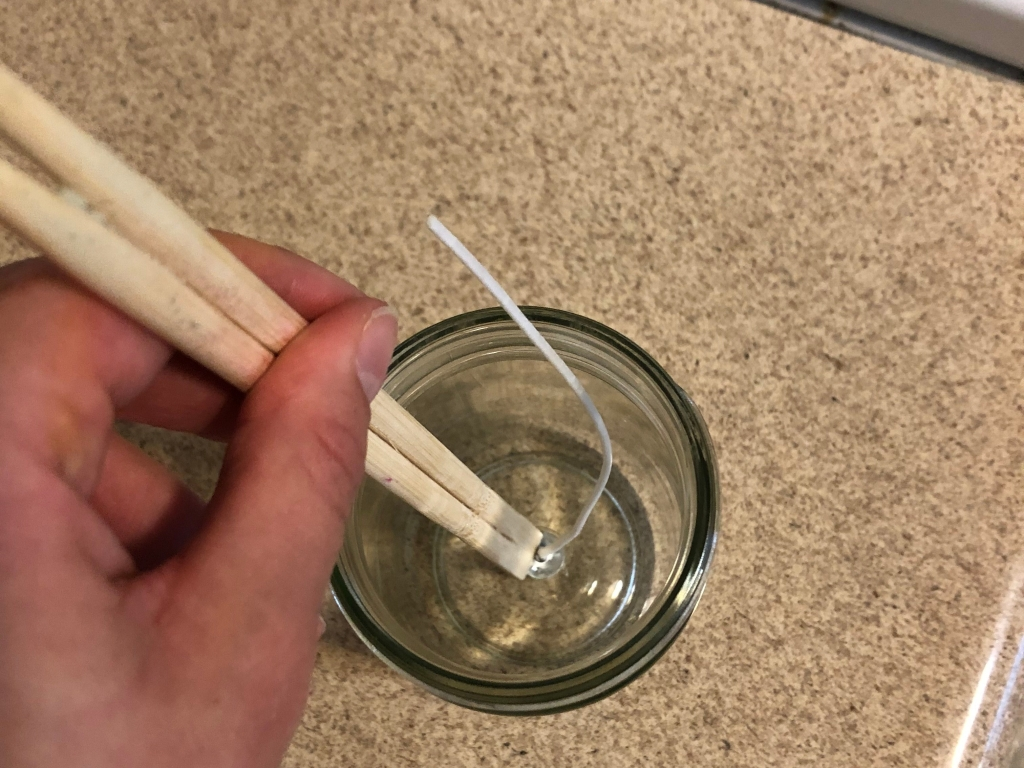 candlemaking wick chopstick glass jar hand